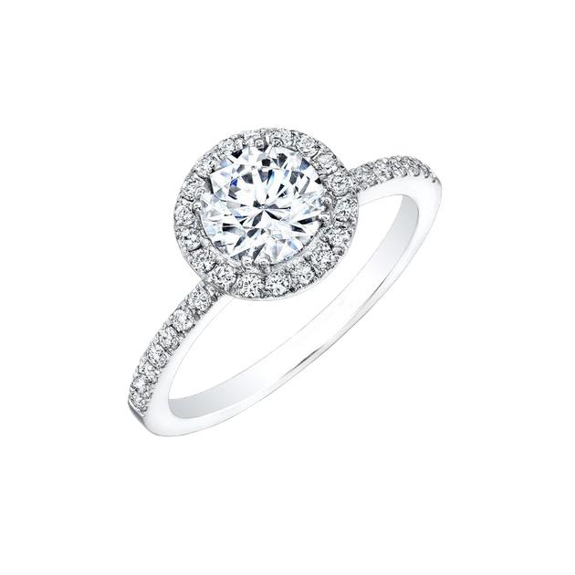 Златен годежен пръстен с централен камък  - топаз в обков от диаманти по периферията.