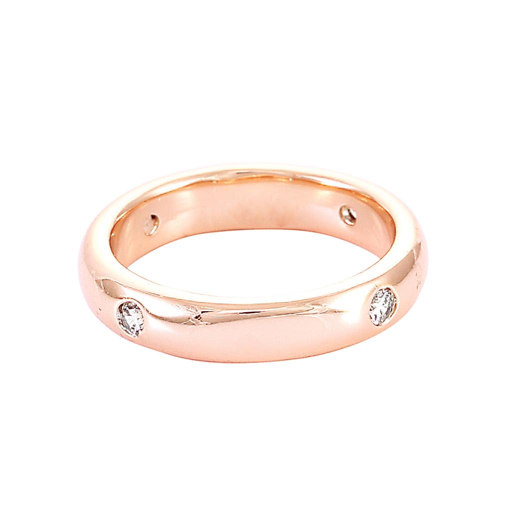 Класическа дамска сватбена халка от розово злато с четири диаманта.