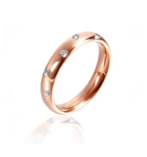Класическа дамска сватбена халка от розово злато, инкрустирана с диаманти под формата на зигзаг.